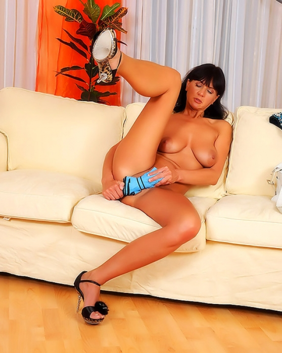 Milf with a delicate shaved pussy